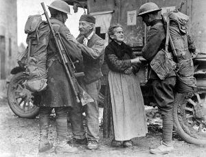 An old French couple, M. and Mme. Baloux of Brieulles-sur-Bar, France, under German occupation for four years, greeting soldiers of the 308th and 166th Infantries upon their arrival during the American advance.
